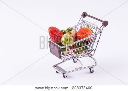 A Shopping Cart With Strawberries Inside Isolated Over White Background