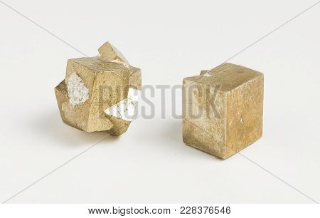 Pyrite Cubes Ore Raw On White Background.cubic, Faces May Be Striated, But Also Frequently Octahedra