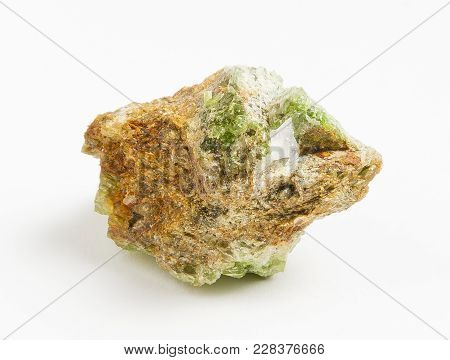 Ore green tourmaline on white background. Tourmaline is a crystalline boron silicate mineral compounded with elements such as aluminium, iron, magnesium, sodium, lithium, or potassium. Classified as a semi-precious stone. poster