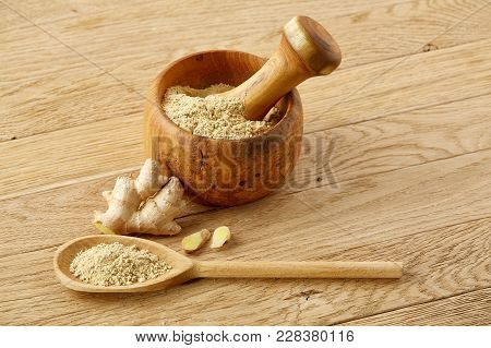 Beautiful Kitchen Still Life Two Transparent Glass Oil Jars, Wooden Mortar Full Of Grind Spicies And