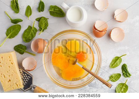 Raw Ingredients For Omelette With Cheese And Spinach. Breakfast Concept, Top View
