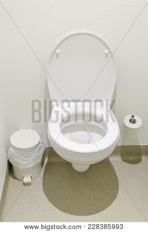 Simple Toilet With Trash Can And Paper In A Budget Hotel