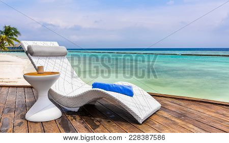 Deckchair And Beautiful Turquoise Indian Ocean In Maldives