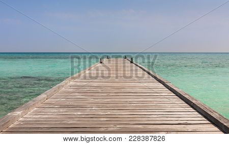 Wooden Jetty And Beautiful Ocean In Maldives