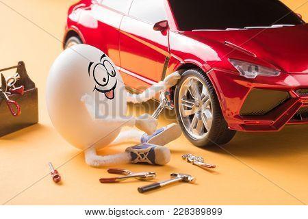 Funny Egg Car Mechanic Repair The Wheel.