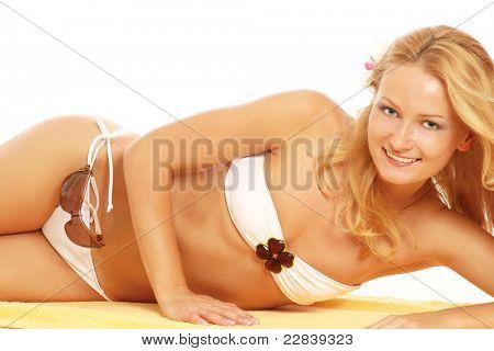 Foto de stock de forma joven en bikini blanco aislado en blanco