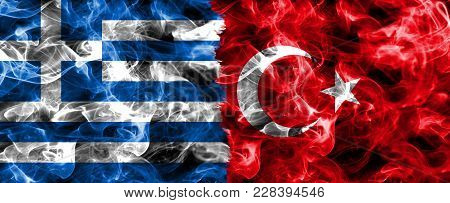 Greece And Turkey Smoke Flag Isolated On A Black Background