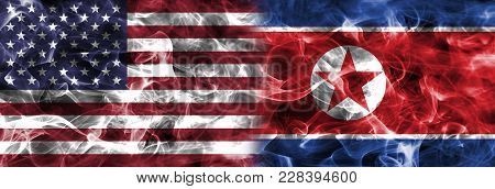 North Korea And United States Of America Smoke Flag Isolated On A Black Background