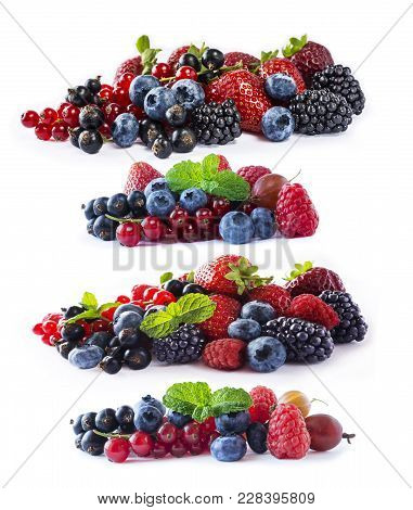 Set Of Fresh Fruits And Berries Isolated A White Background. Ripe Blueberries, Blackberries, Currant