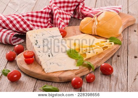 Various Type Of Italian Cheeses On Wooden Table.