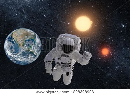Astronaut In Outer Space Over The Planet Earth. This Image Is A Collage Of Different Images Furnishe