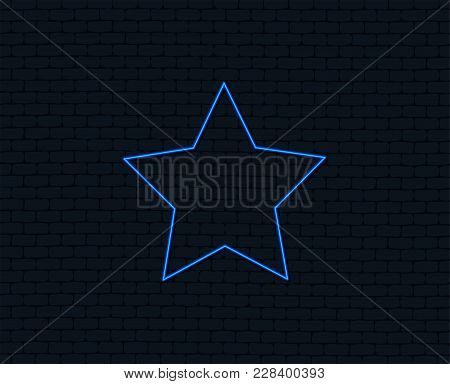 Neon Light. Star Sign Icon. Favorite Button. Navigation Symbol. Glowing Graphic Design. Brick Wall.