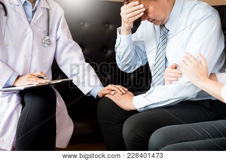 Medical Doctor Holing Senior Patient's Hands For Encouragement Cheering And Support.