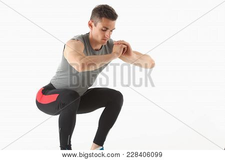 Fitness Man Crouchs From Floor Demonstrates Good Physical Fitness Exercises Isolated White Backgroun