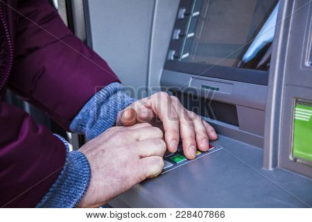 Hands Typing Pin At Atm Machine For Cash Money Withdrawal. Close Up For Hands Typing On Atm Maschine