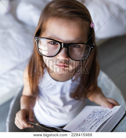Preschooler Girl With Books And Glasses. Teaching, Student, Education A