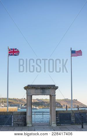 The Famous Mayflower Steps In Plymouth With The Union Flag And Stars And Strips Flying Either Side
