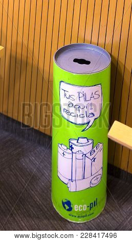 Barcelona, Spain - 12 January 2018: Waste Bin For Used Batteries With The Inscription, Tus Pilas Aqu