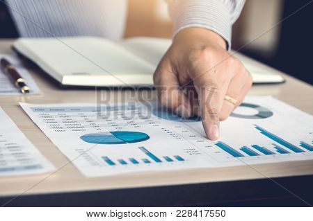 Hand Man Pointing Number On Chart Report.