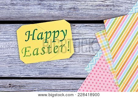 Easter Greeting Card On Wooden Background. Easter Congratulations On Yellow Paper Sheet. Sheets Of C