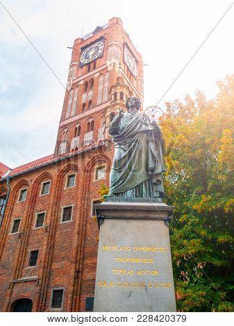 Torun, Poland - August 27, 2014: Statue Of Nicolaus Copernicus, Renaissance Mathematician And Astron