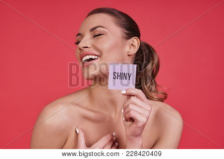 Sensitive Care For A Luminous Skin.  Beautiful Young Woman Smiling And Keeping Eyes Closed While Sta