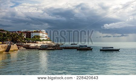 Stone Town, Zanzibar - February 8, 2017: Seafront With Boats On Calm Sea.