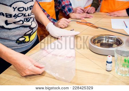 Hands Hold Confectionery Bag Swith Macaron Batter