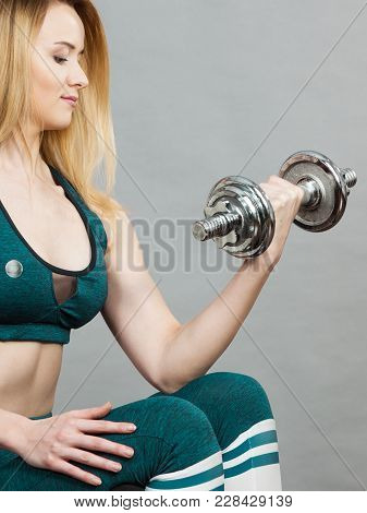 Young Teenage Woman Training Weight Lifting At Gym, Holding Heavy Dumbell. Being Fit And Healthy, Ar
