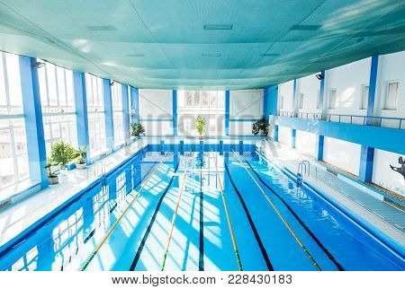 An Interior Of An Indoor Public Swimming Pool. High Angle View.