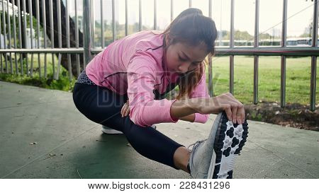 Fitness Sport Girl Fashion Sportswear Doing Yoga Fitness Exercise In Street. Fit Young Asian Woman D