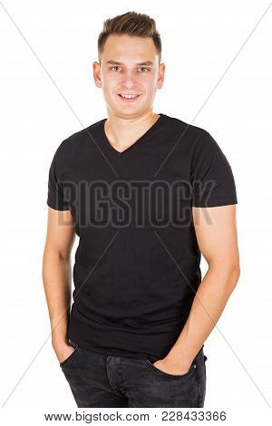 Handsome Young Man Smiling At The Camera On Isolated Background