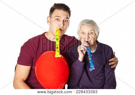 Disabled Elderly Woman Celebrating Birthday With Loving Grandson On Isolated