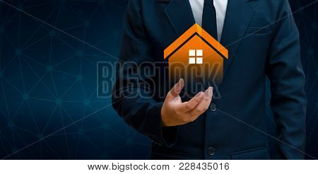 The House Is In The Hands Of The Business Man  Home Icon Or Symbol Concept Of Home Automation Home A