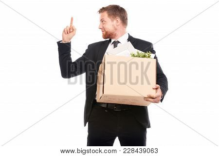 Office Worker In Suit Holding Box With Personal Belongings On White Background