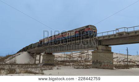 Kazakhstan, Ust-kamenogorsk, February 23, 2018: Diesel Locomotive. Freight Train On A Railway Bridge
