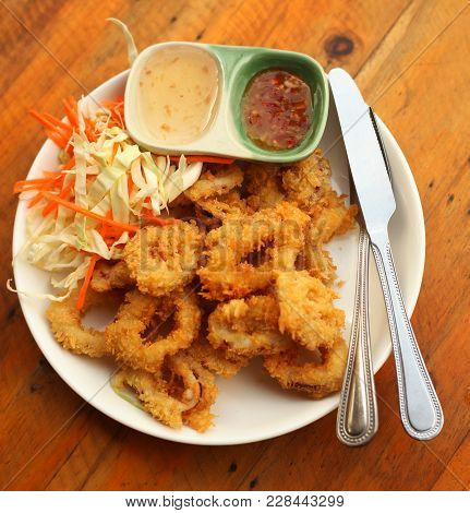 Seafood Platter With Deep Fried Squid Rings, Salad Sweet And Sore Sauce Served For Lunch
