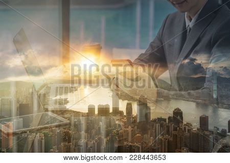 Double Exposure Of Businessman Asian Businessman Hand Holding And Using The Smart Phone And Laptop O