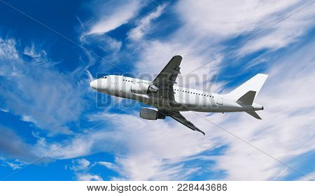 Airplane Flying In The Sky - Travel Background With Flying Airplane. Airplane Closeup. Airplane With