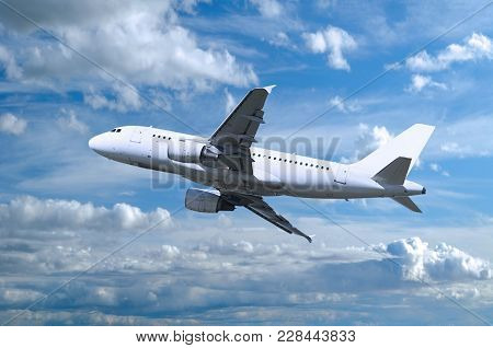 Airplane Flying In The Sky, Travel Background With White Airplane. Airplane Closeup. Airplane With B