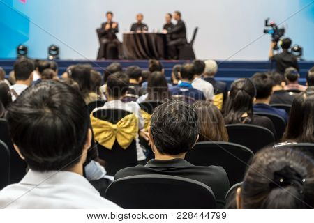 Speakers On The Stage With Rear View Of Audience In The Conference Hall Or Seminar Meeting, Business