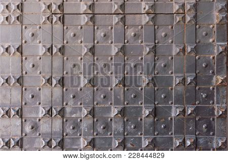 Metallic Background From Medieval Door With Forged Rivets.