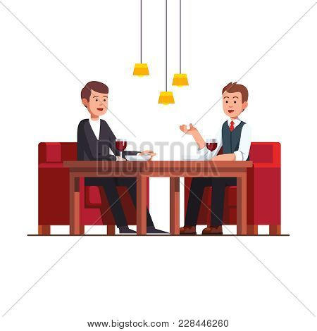 Two Business Man Eating Lunch At Restaurant. Businessman Talking With Potential Client At Cafe Discu