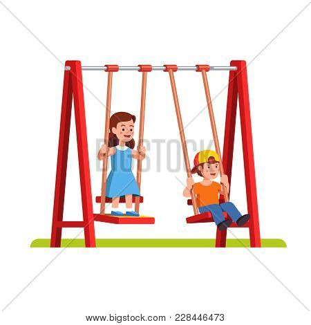 Happy Little Boy And Girl Swinging On Swing In Public Park Or Kindergarten Playground. School Or Pre