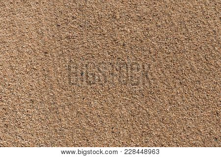 Background Of Smoothed Sea Beach Sand Close-up.