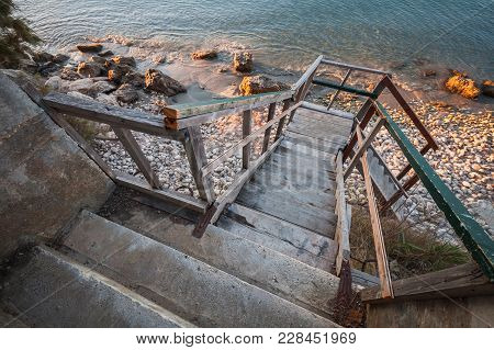 Perspective View Of Old Wooden Stairs Going Down To The Beach. Zakynthos Island, Greece