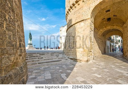 Otranto, Italy - April 11, 2010: People Valking Near The Alfonsina Tower