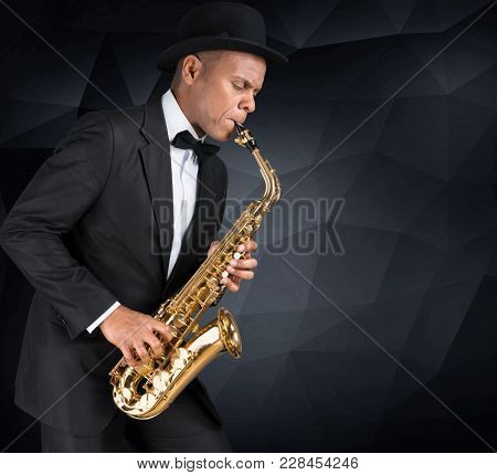 Sax images illustrations vectors sax stock photos images play man playing sax saxophone entertainment background voltagebd Images