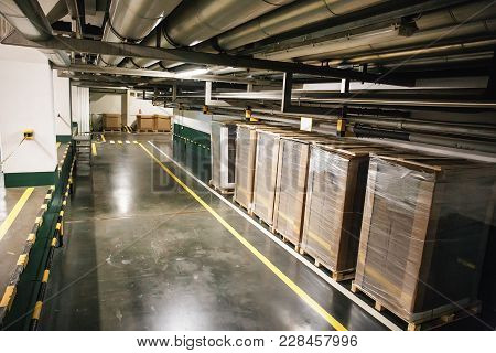 Industrial Warehouse Or Logistic Hangar Interior. Boxes And Pipelines In Corridor, Industrial Backgr