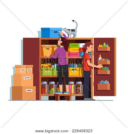 Family Couple Man, Woman Working Together Putting Boxes To Home Pantry Or Cellar Cupboard Shelves. S
